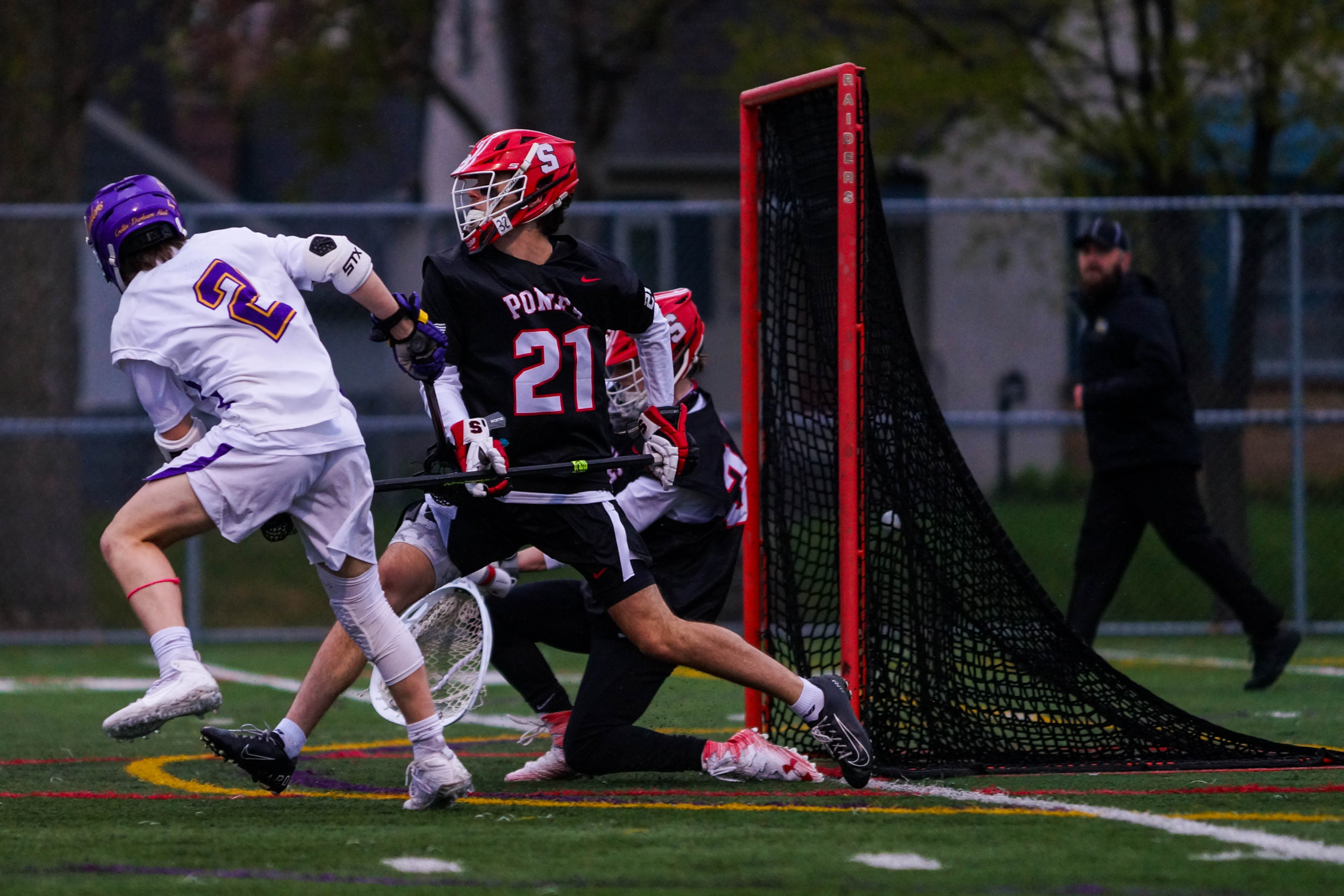 Cretin-Derham Hall junior Luke McCarthy (2) records one of his two goals Wednesday at home against Stillwater. The Raiders lost to the Ponies 5-4. Photo by Korey McDermott, SportsEngine