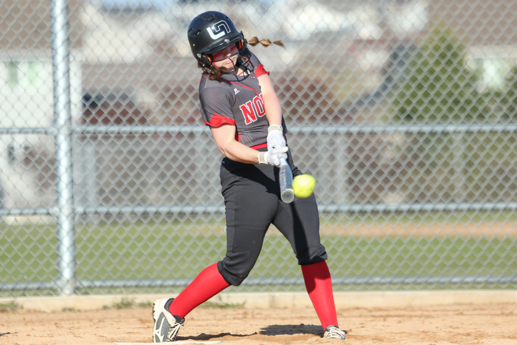Lakeville North's Arianna Loesch connects for a single in the bottom of the eighth inning against Rosemount Wednesday evening. The Panthers defeated the Irish 2-1 in eight innings in Lakeville. Photo by Jeff Lawler, SportsEngine