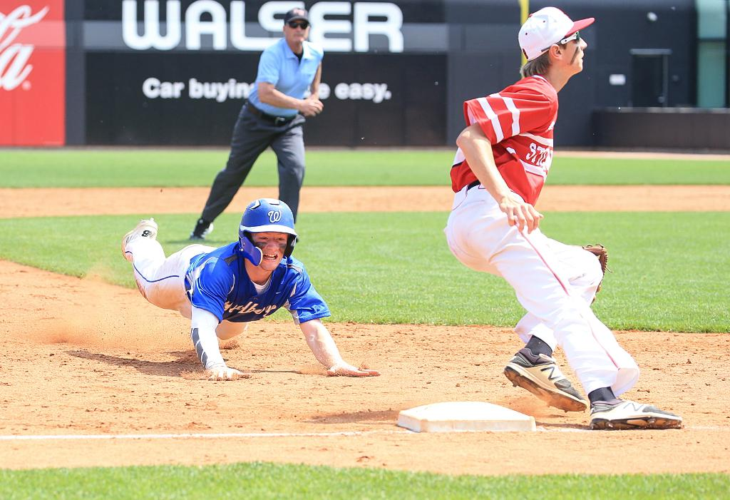 Brock Rinehart dives into third base just before heading for home on a wild throw to third, giving Woodbury a 2-0 lead in the sixth inning. Photo by Cheryl Myers, SportsEngine