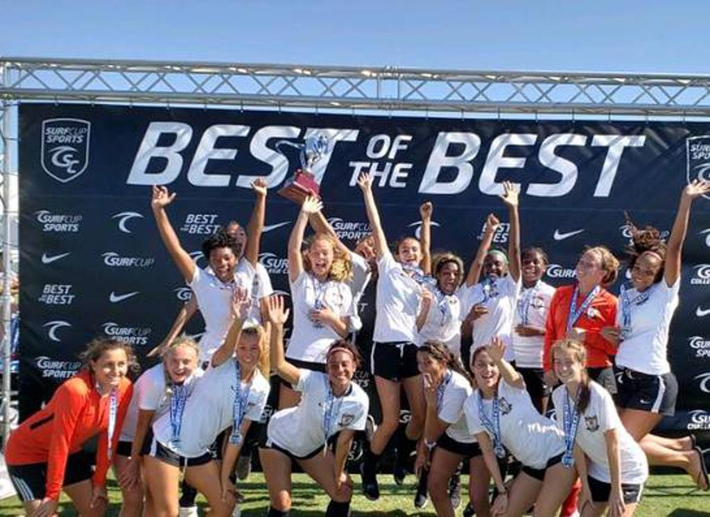 Strikers U17 ECNL team celebrates their Championship at the 2018 Surf Cup