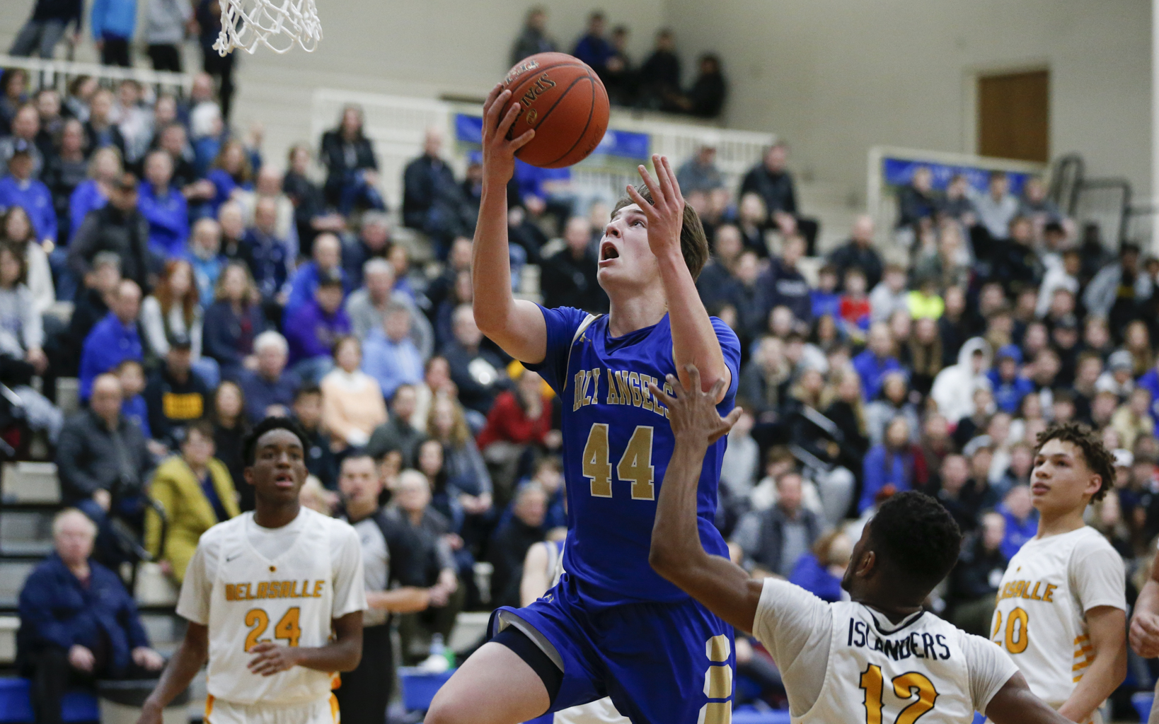 Holy Angels' Matt Banovetz (44) goes up for two of his 26 points against DeLaSalle Friday night. Banovetz eclipsed the 1000 point mark in the Stars' 59-56 loss to the Islanders in Richfield. Photo by Jeff Lawler, SportsEngine
