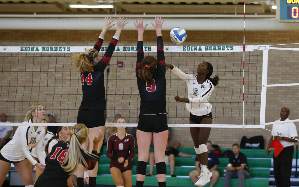 Southwest Christian's Callie Coughlin sends a shot past two North Branch defenders during the Breakdown Sports Side Out Classic at Edina High School. The Stars fell to the Vikings in an entertaining five set match. Photo by Jeff Lawler, SportsEngine