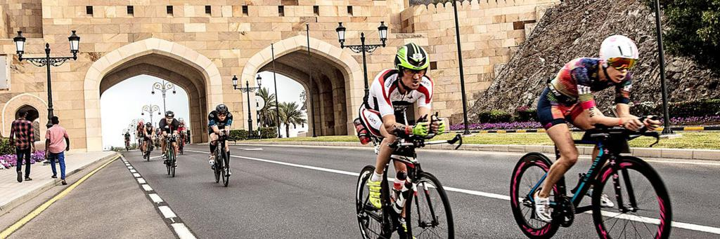 Bikers participating in IRONMAN 70.3 Oman