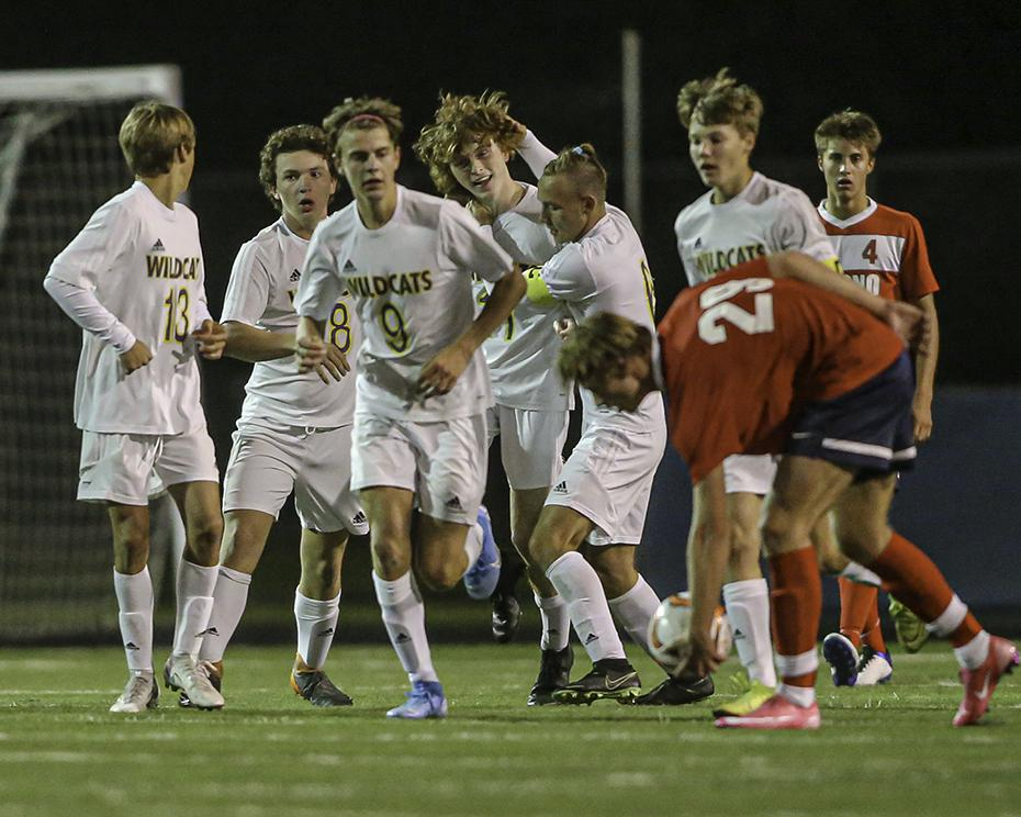 Waconia teammates swarm around senior Michael Bortz (fourth from left) after his goal in the game's closing seconds. Waconia rallied to tie Orono 1-1. Photo by Mark Hvidsten, SportsEngine