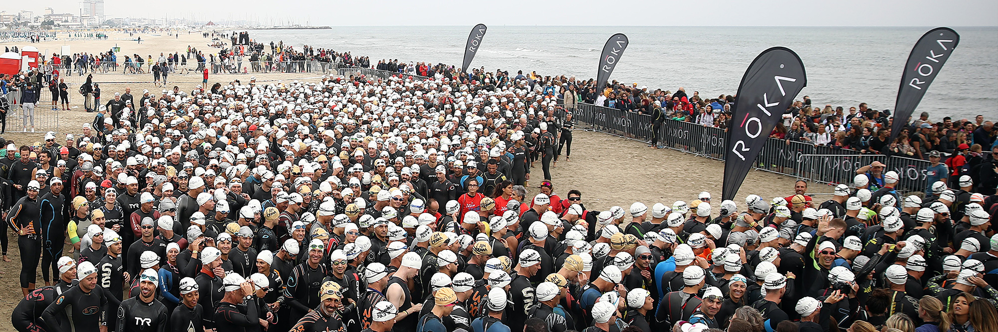 Hundreds of athletes are lining up at the swim start on the beach of Cervia to get into the Adriatic Sea