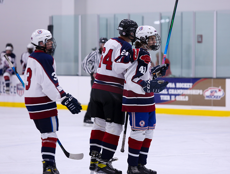 Brayden Orlowski (41) is congratulated by Cherokee Trail teammates following one of his two goals against Mountain Ice on Friday. Cherokee Trail won the matchup 6-2. Photo by Katie Hinkle, SportsEngine