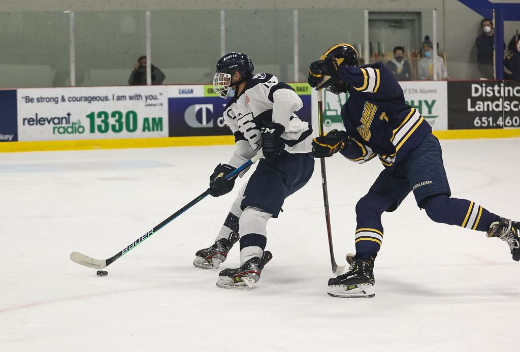 Senior Jared Wright (16) gets past a Rosemount defender and puts the Cadets up by two goals to close out the first period. St. Thomas Academy cruised to a 6-1 win in the Class 2A, Section 3 final on Wednesday night. Photo by Cheryl A. Myers, SportsEngine