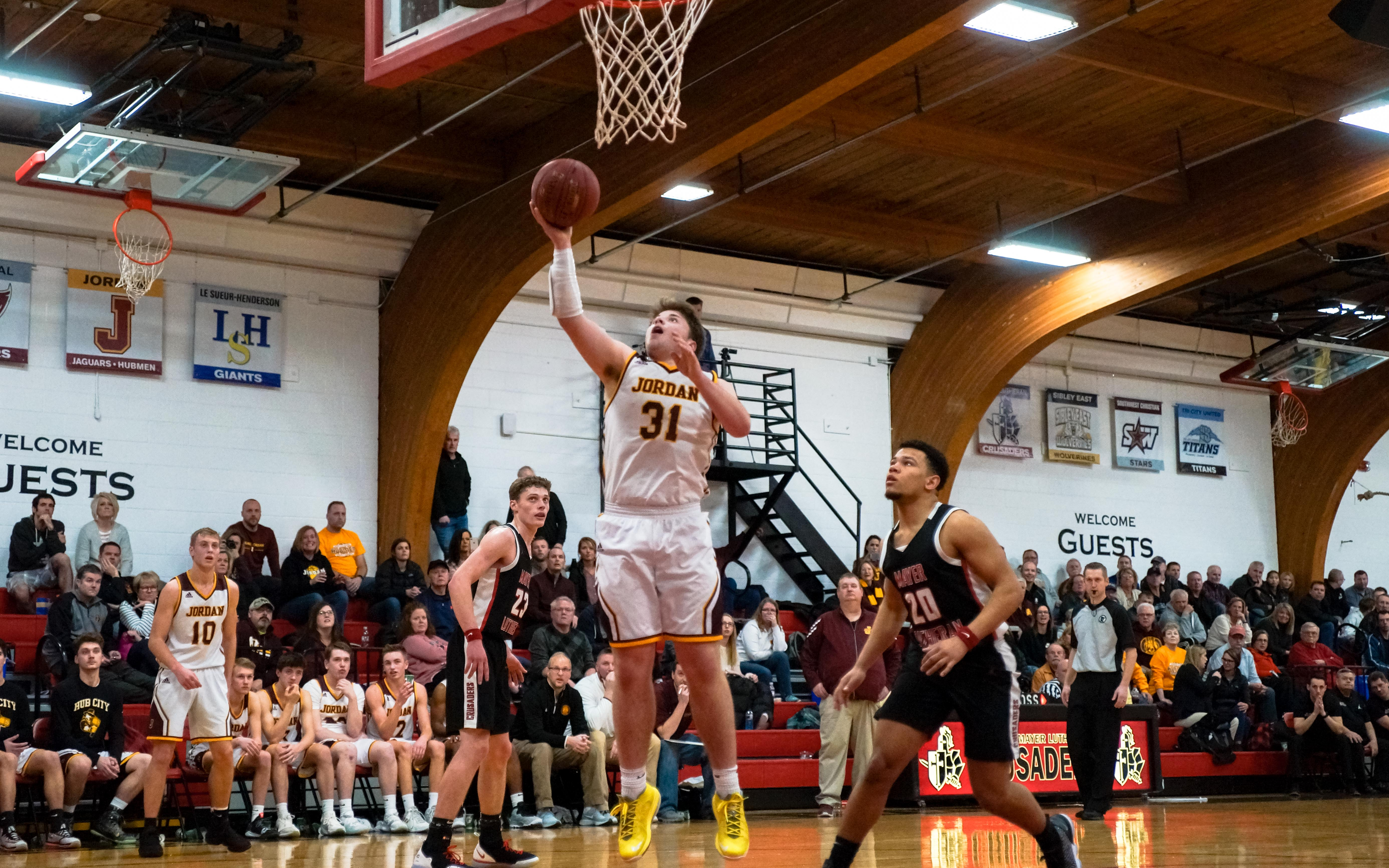Jordan's Thomas Gutzmer with two of his 12 points in Tuesday night's 62-50 road victory over Mayer Lutheran. Photo by Korey McDermott, SportsEngine