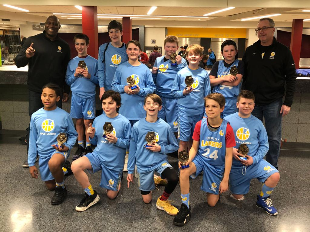 Minneapolis Lakers Boys 6th Grade White pose with their first place trophies at the MYAS Supersaver in St. Paul, MN
