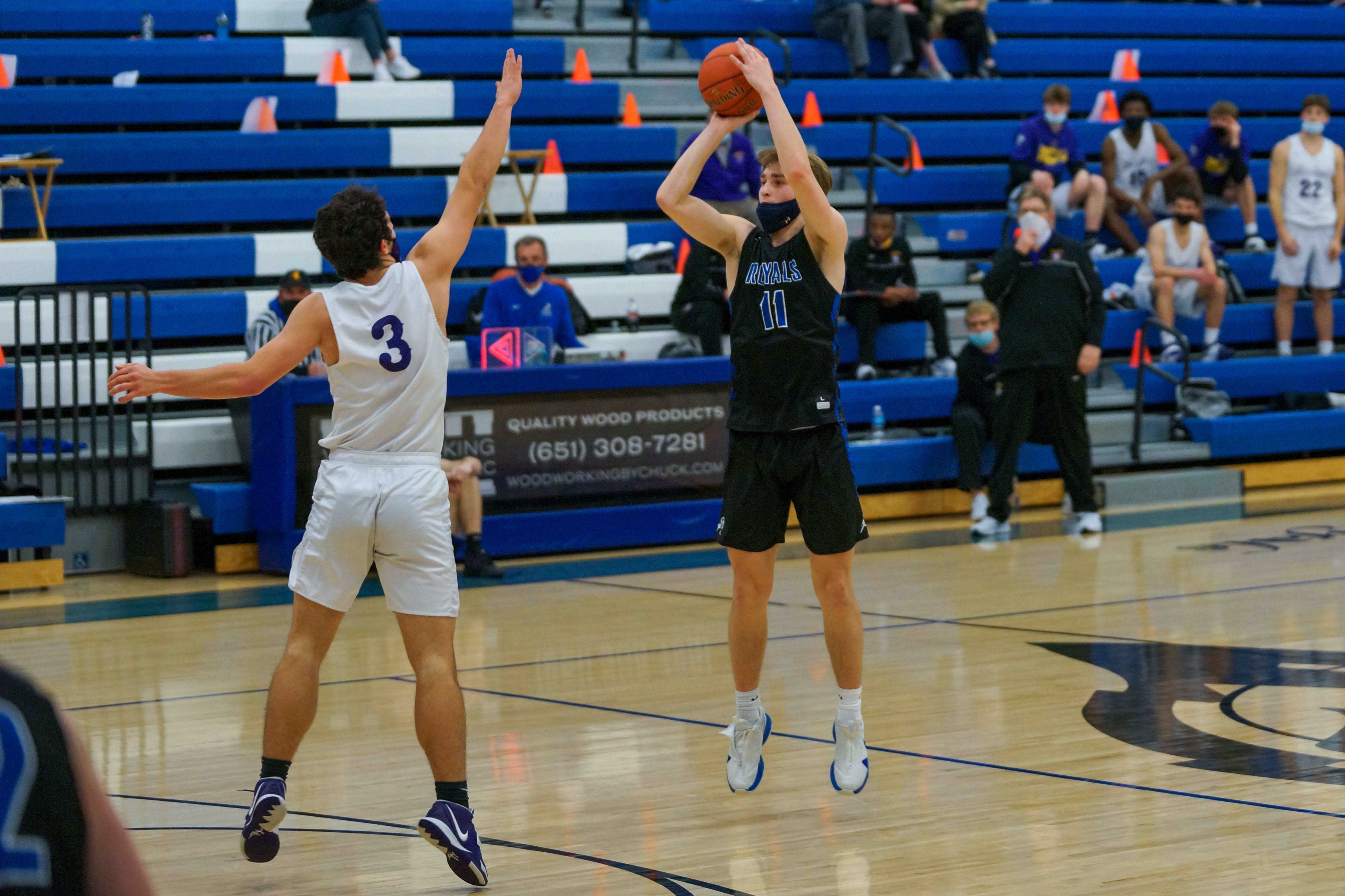 Woodbury senior guard Bradley Cimperman (11) led his team in scoring with 21 points, but the top-seeded Royals fell short of their state tournament aspirations by losing 58-55 Friday night. Photo by Korey McDermott, SportsEngine
