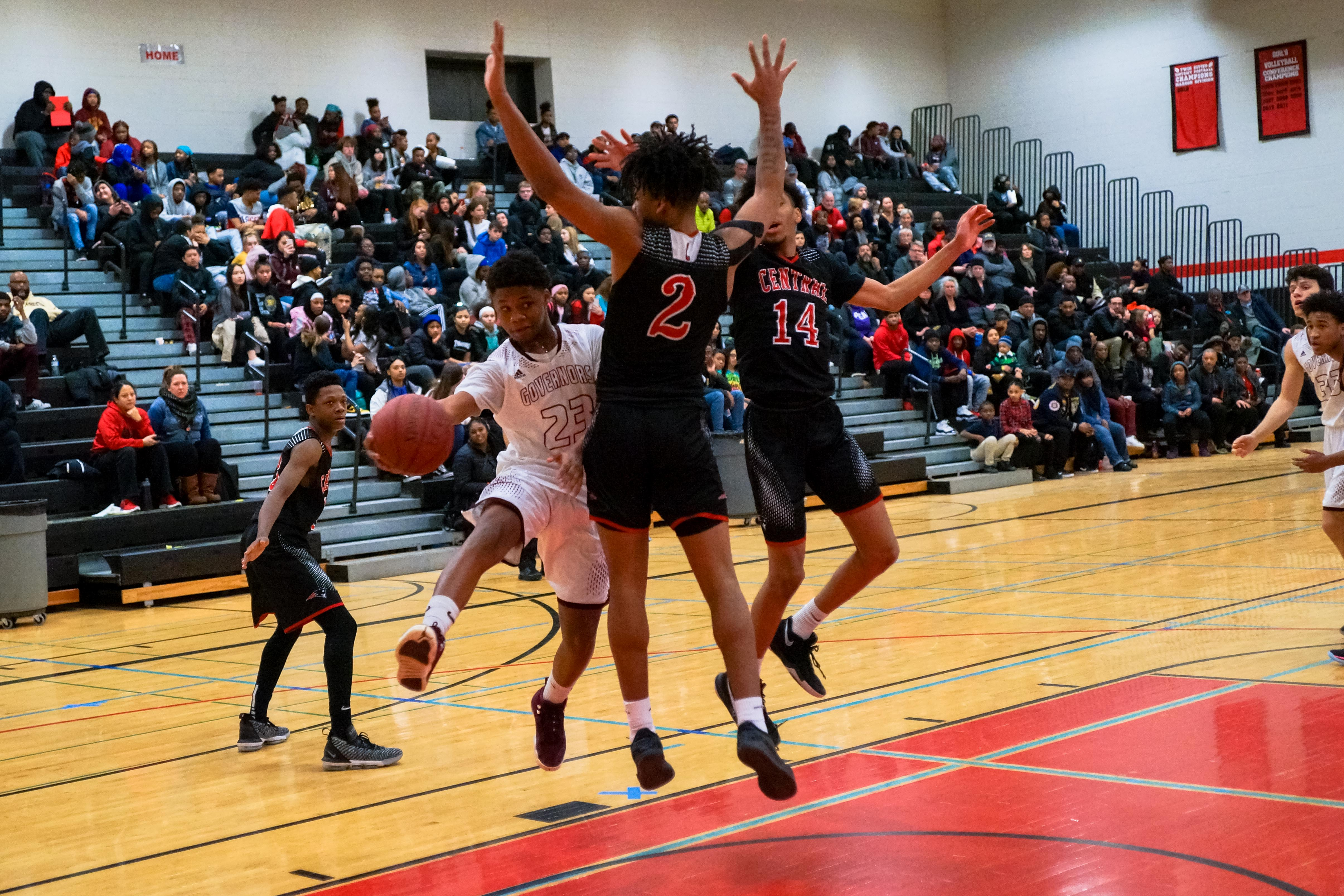 St. Paul Central teammates Ricardo Martinez (2) and Donnie Preston (14) force St. Paul Johnson's Jordan Gaultney to pass after an attempted drive to the basket. Photo by Korey McDermott, SportsEngine