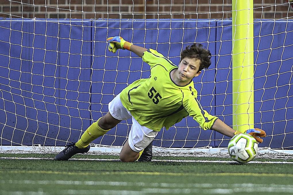 Freshman goaltender Logan Langer made the stop on a penalty kick by Blake's Keegan James to preserve a 2-1 lead with nine minutes to play. Photo by Mark Hvidsten, SportsEngine