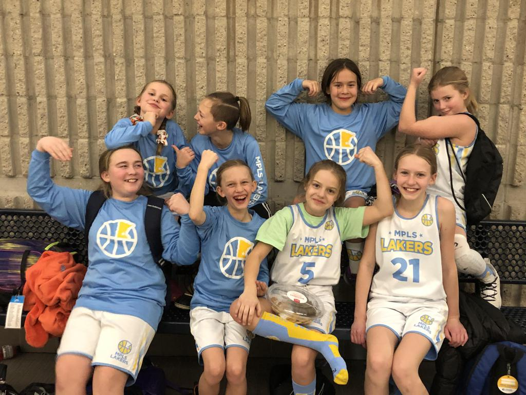 Minneapolis Lakers Youth Basketball Program 5th Grade Blue girls pose after earning 3rd place at the Eastview Lightning Classic tournament in Apple Valley, MN