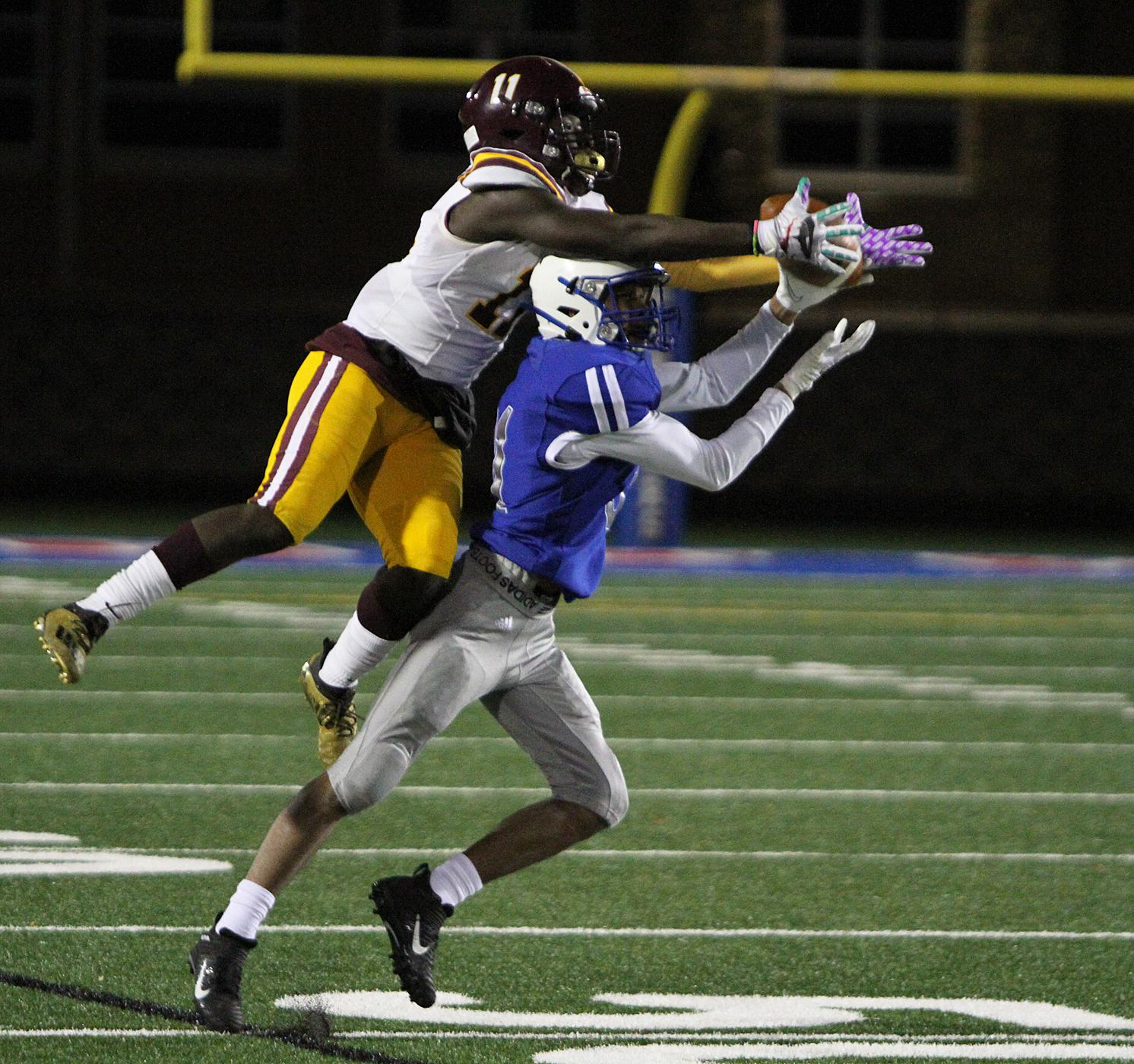 Spring Lake Park defensive back Tossy Johnson-Kelly and Irondale receiver CJ Ritchie fight for a ball in the flat during the fourth quarter. The pass fell incomplete. Photo by Drew Herron, SportsEngine