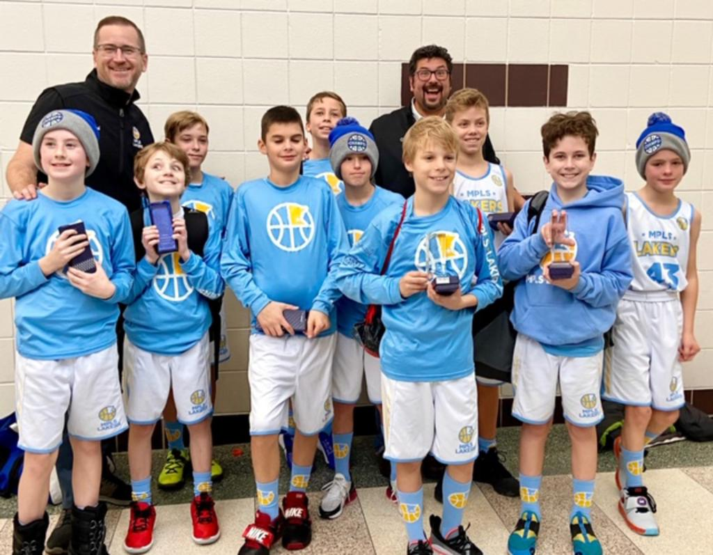 Minneapolis Lakers Boys 5th Grade White pose with their trophies after earning 2nd place at the Orono Spartan Classic tournament in Orono, MN