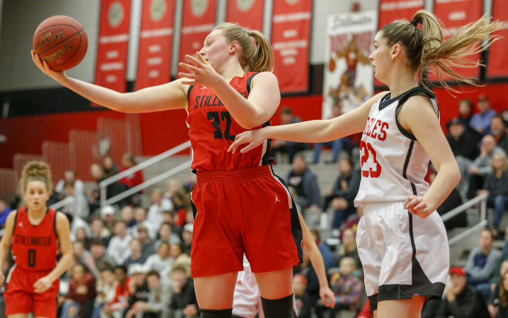 Stillwater junior Aliza Karlen pulls down a rebound against Eden Prairie Saturday night. Karlen had 14 points in the Ponies' 78-63 victory over the Eagles. Photo by Jeff Lawler, SportsEngine