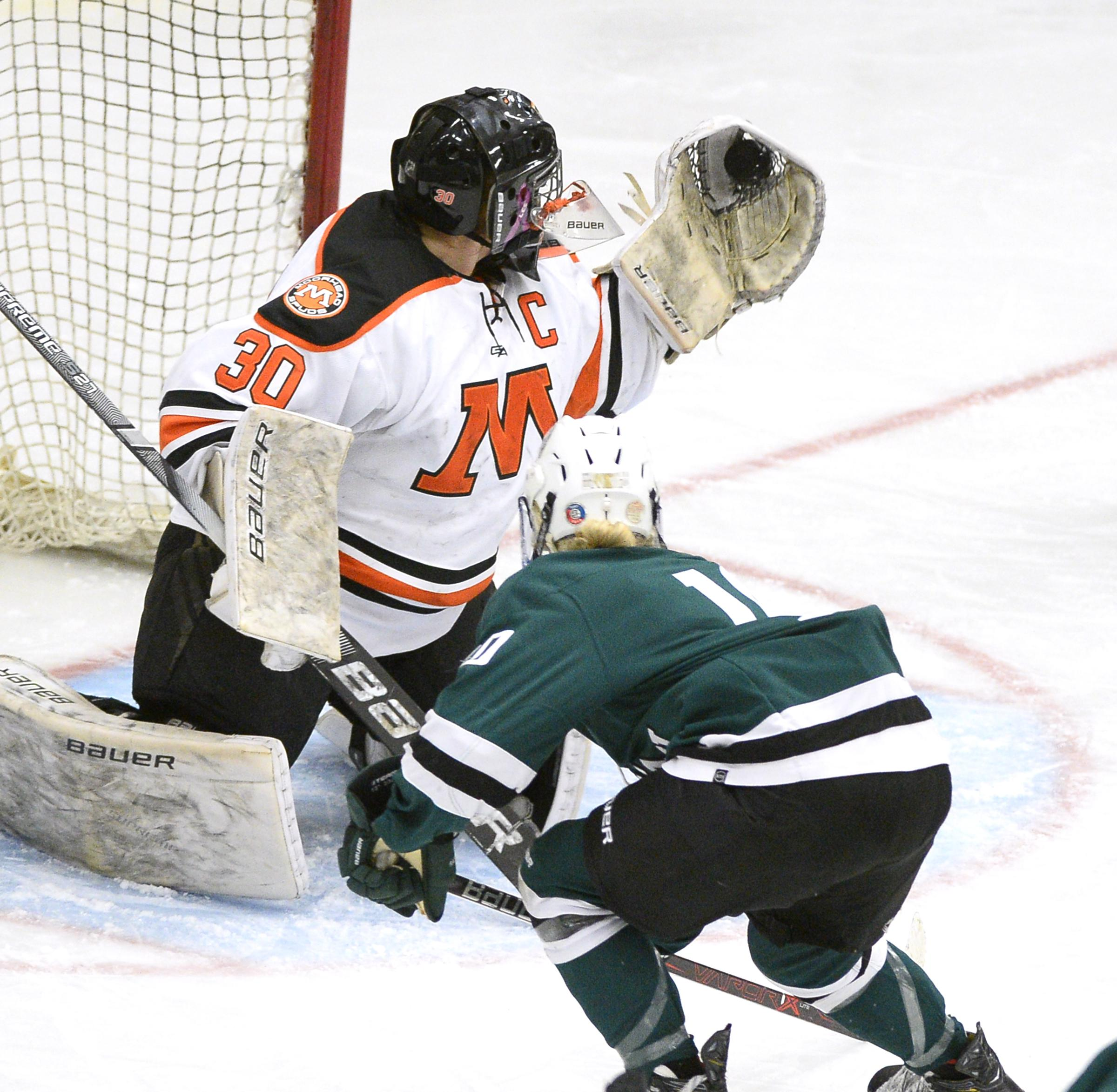 Moorhead goaltender Paige Schmidt (30) gloves a shot from Roseau's Anika Stoskopf. Schmidt made 53 saves on 59 shots for the Spuds. Moorhead lost at home 6-0 to Roseau. Photo by Tim Kolehmainen, SportsEngine