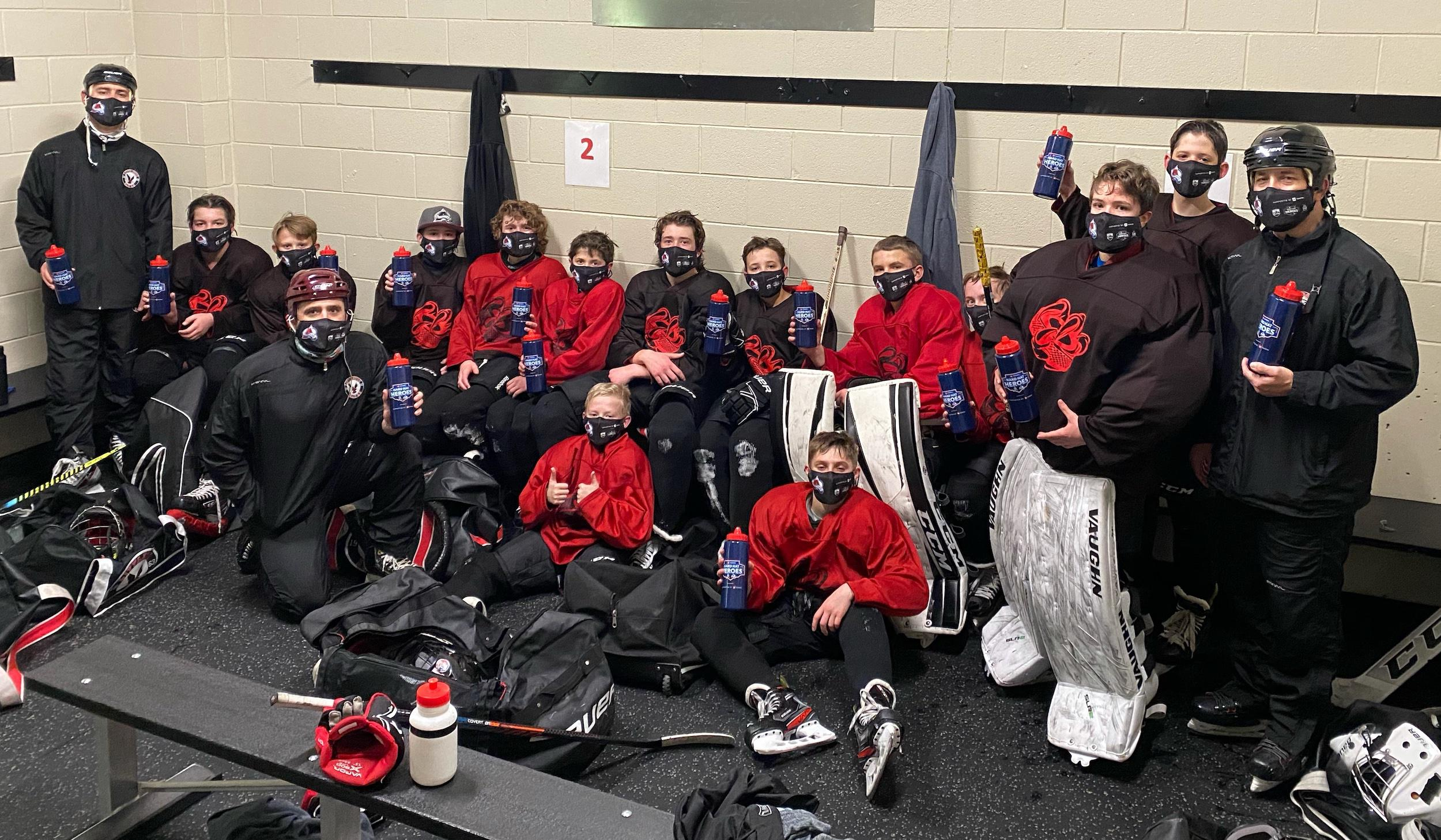 The Littleton Hockey Association Bantam B team received water bottles and face masks at practice. Photo courtesy of Brian TenEyck
