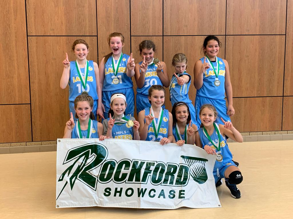 Girls 5th Grade Gold pose with their hardware after taking 1st at Rockford Showcase