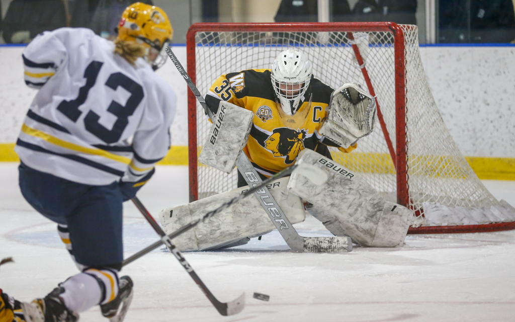 Warroad goalie Quinn Kuntz stares down a shot from Breck's Ashley Halverson. Kuntz stopped all 23 Mustang shots for her fifth shutout of the young season. Photo by Jeff Lawler, SportsEngine
