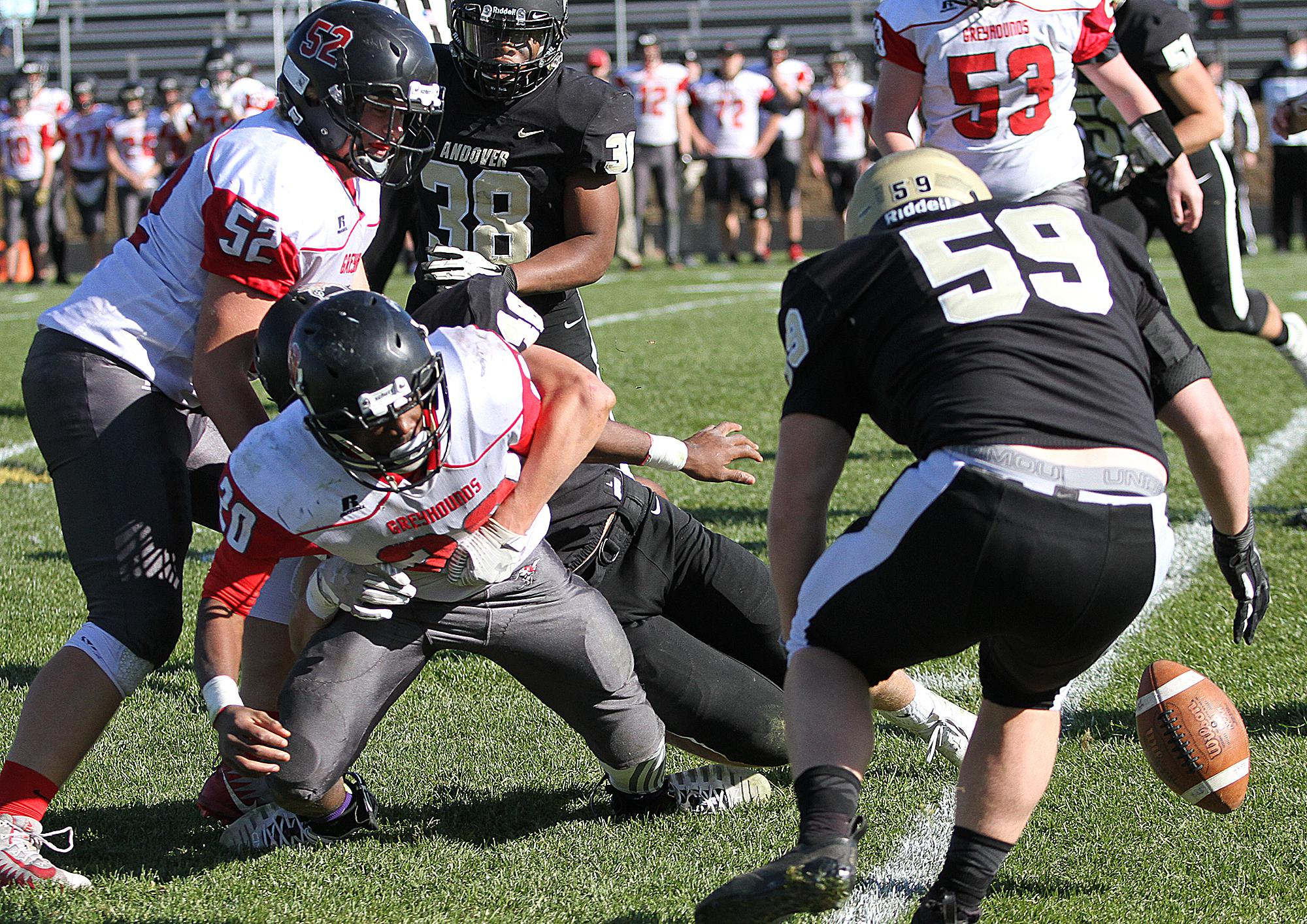 Andover defensive lineman Justin Kenning (59) recovers a fumble late in the second quarter. The takeaway set up a quick score by the Huskies, who raced to a 35-0 first-half lead over visiting Duluth East Saturday. Photo by Drew Herron, SportsEngine