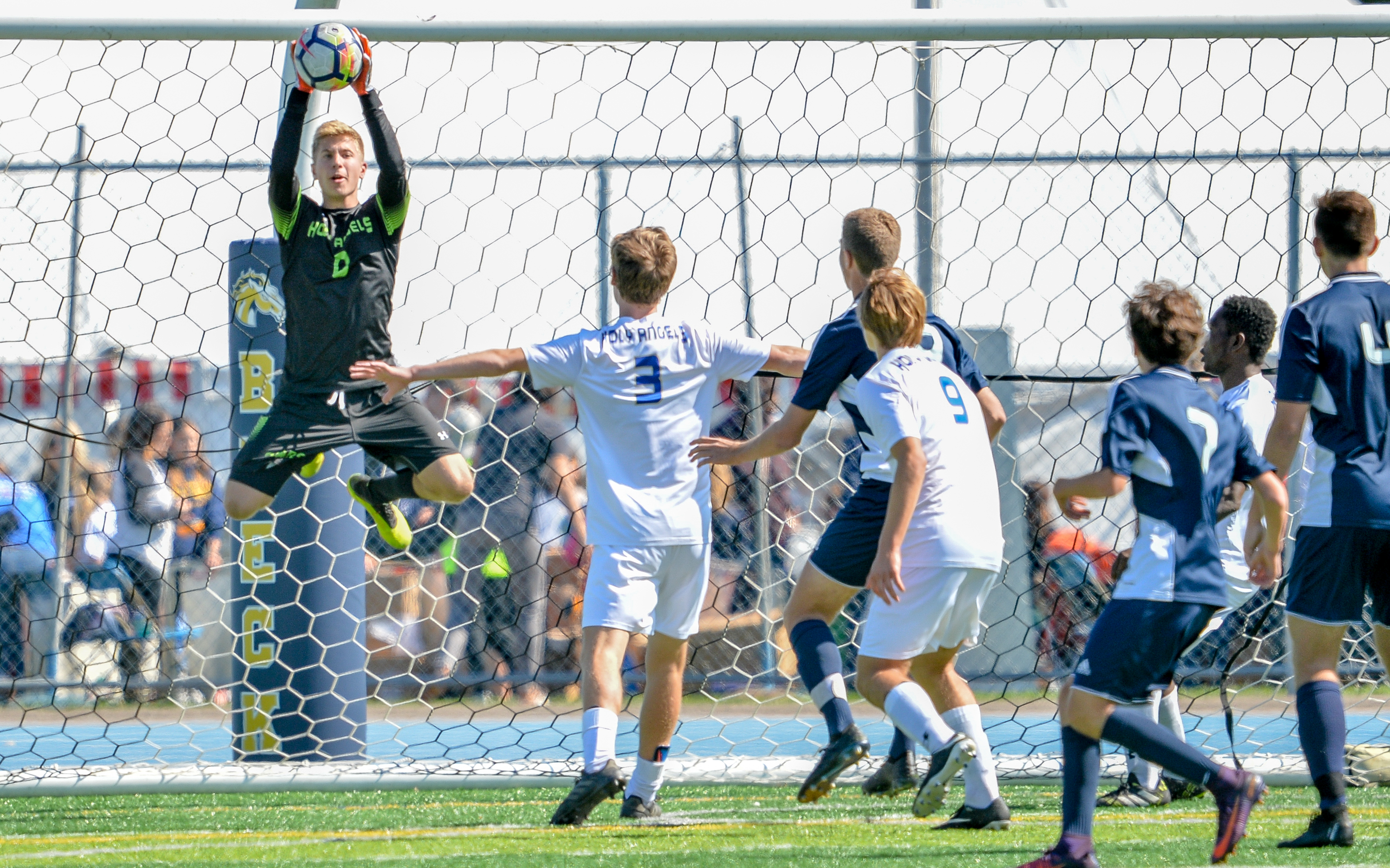 Holy Angels goalkeeper Peter Forseth keeps the ball from the back of the net in the first half as the Stars and Mustangs end in a 0-0 double overtime tie on Saturday. Photo by Earl J. Ebensteiner, SportsEngine