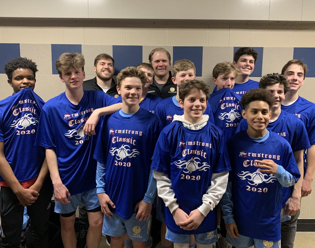 Mpls Lakers Youth Traveling Basketball Program Inc Boys 8th Grade Gold pose with their T-Shirts after becoming the Champions at the Armstrong Classic tournament in Robbinsdale, MN