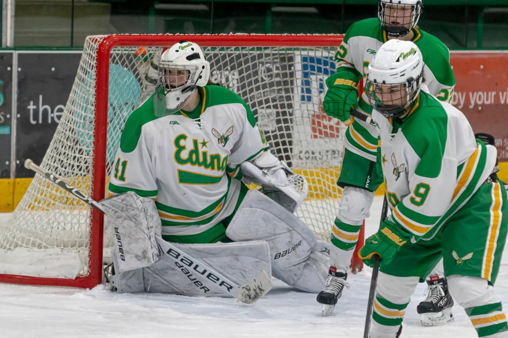 Freshman goalie Uma Corniea (41) and Edina's tough defensive unit held Breck to one goal in the Hornets' 6-1 defeat of the Mustangs at Braemar Arena. Photo by Gary Mukai, SportsEngine