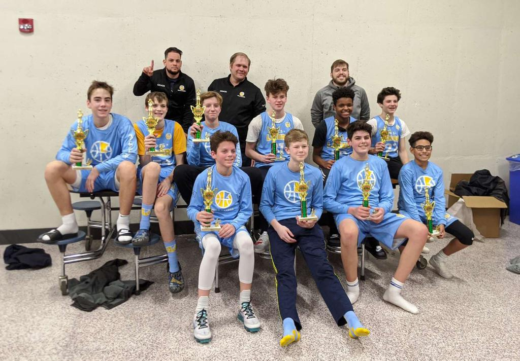 Mpls Lakers Youth Traveling Basketball Program Inc Boys 8th Grade Gold pose with their Trophies after becoming the Champions at the Edina Cake Eater Classic tournament in Edina, MN