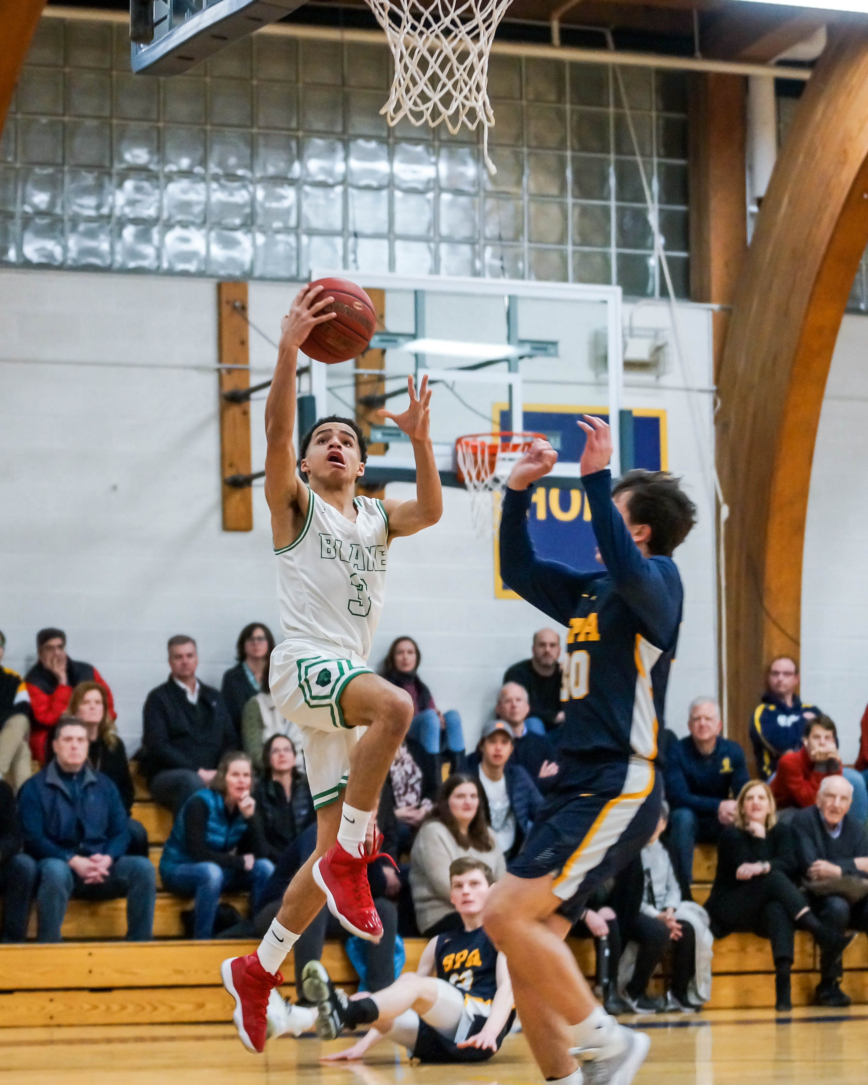 Blake junior Robert Grace IV (3) with a look at the basket over St Paul Academy's Ethan Richman on Feb 7. Photo by Korey McDermott, SportsEngine