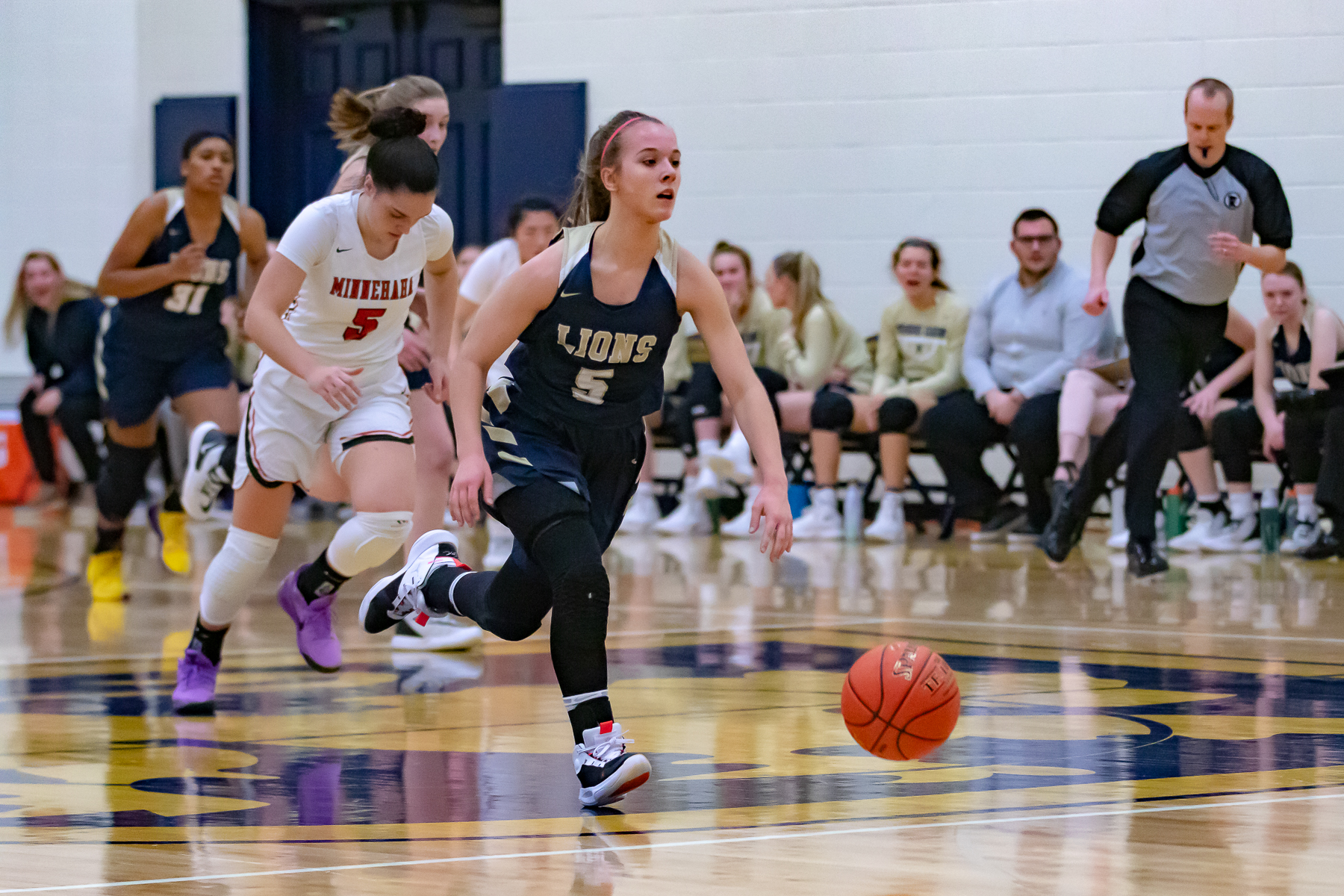 Providence Academy's Hailey Hohenecker (5) steals the ball and scores two of her 18 points. Hohenecker and the Lions defeated visiting Minnehaha Academy 59-38 Tuesday Night. Photo by Gary Mukai, SportsEngine