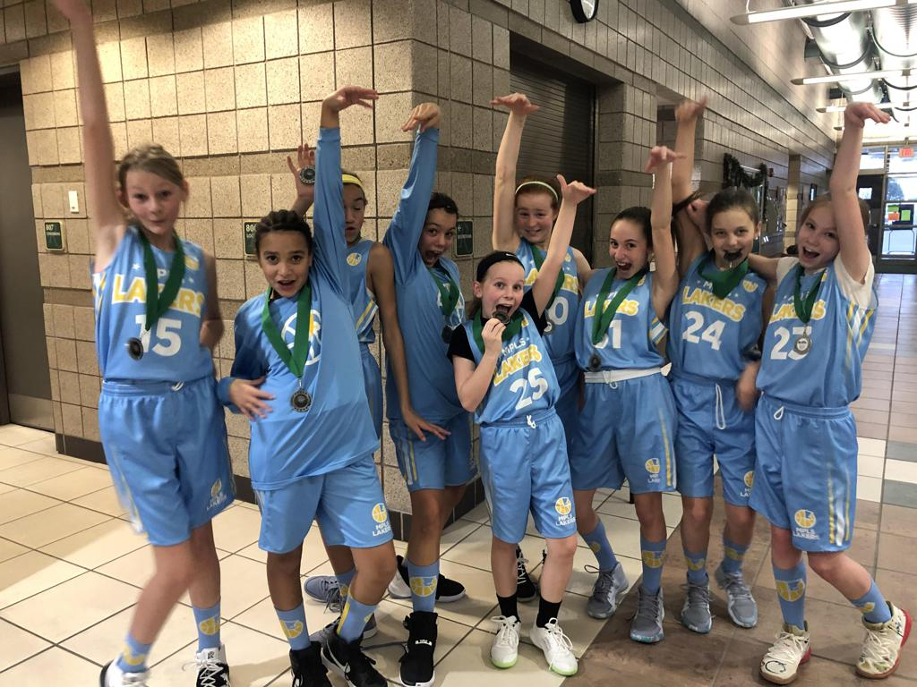 Minneapolis Lakers Girls 6th Grade Blue pose with their medals after earning 2nd place at the Rockfrod Girls Showcase tournament in Rockford, MN