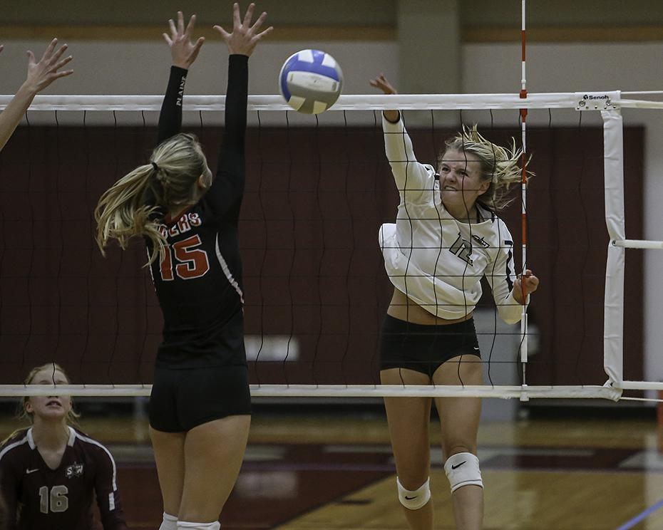 Southwest Christian hitter Paige Lemkull (15) powered a shot past Belle Plaine's Brianna Swenson. Photo by Mark Hvidsten, SportsEngine