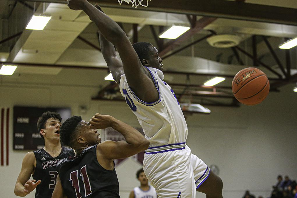 Quientrail Jamison-Travis came down after a second-half dunk over St. Paul Johnson's Larry Harris (11). Jamison-Travis had 27 points and 11 rebounds in Minneapolis North's victory. Photo by Mark Hvidsten, SportsEngine