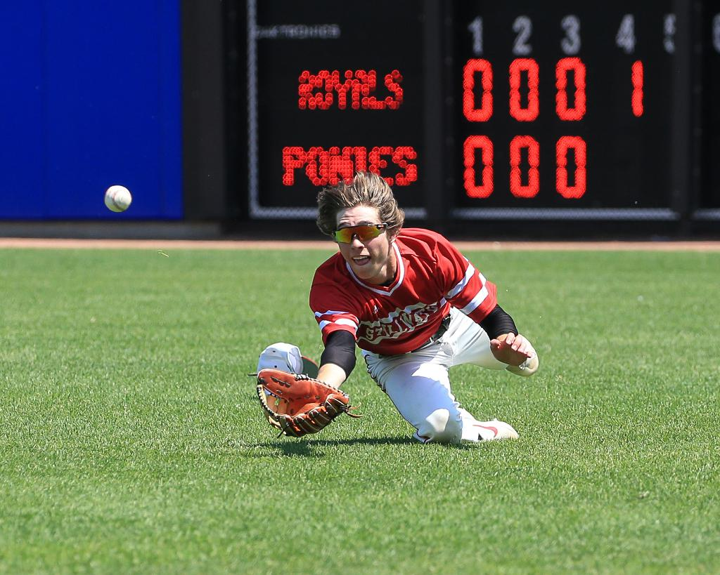 Kade Peloquin's diving catch left a Woodbury runner stranded at third, holding the Royals to just one run in the top of the fourth inning. Photo by Cheryl Myers, SportsEngine