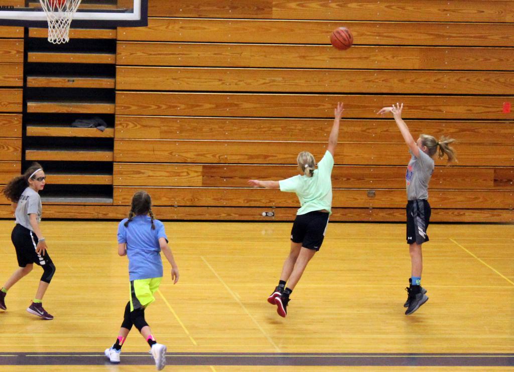 8th grade girls practicing jump shots