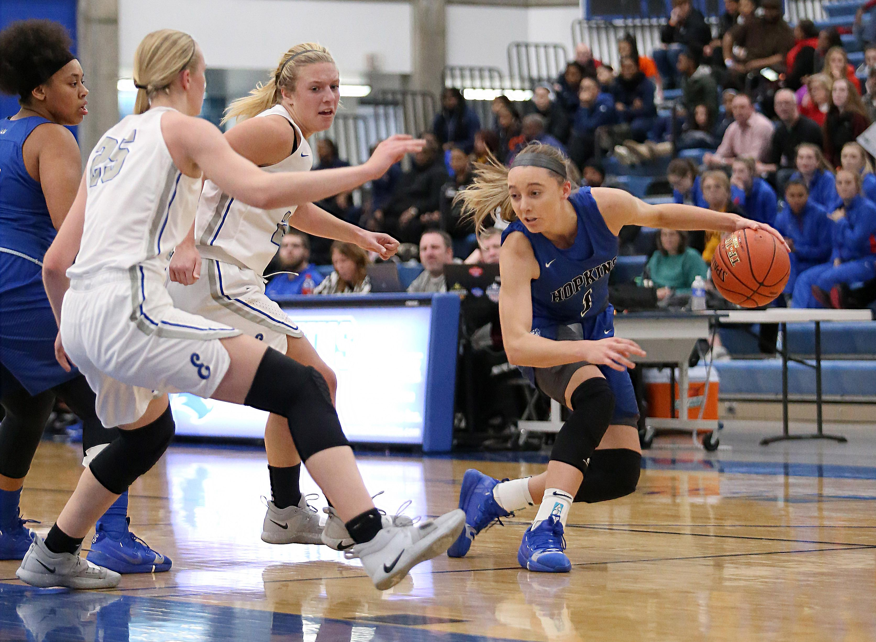 Paige Bueckers works her way past two Eastview defenders on Saturday. Photo by Cheryl Myers, SportsEngine