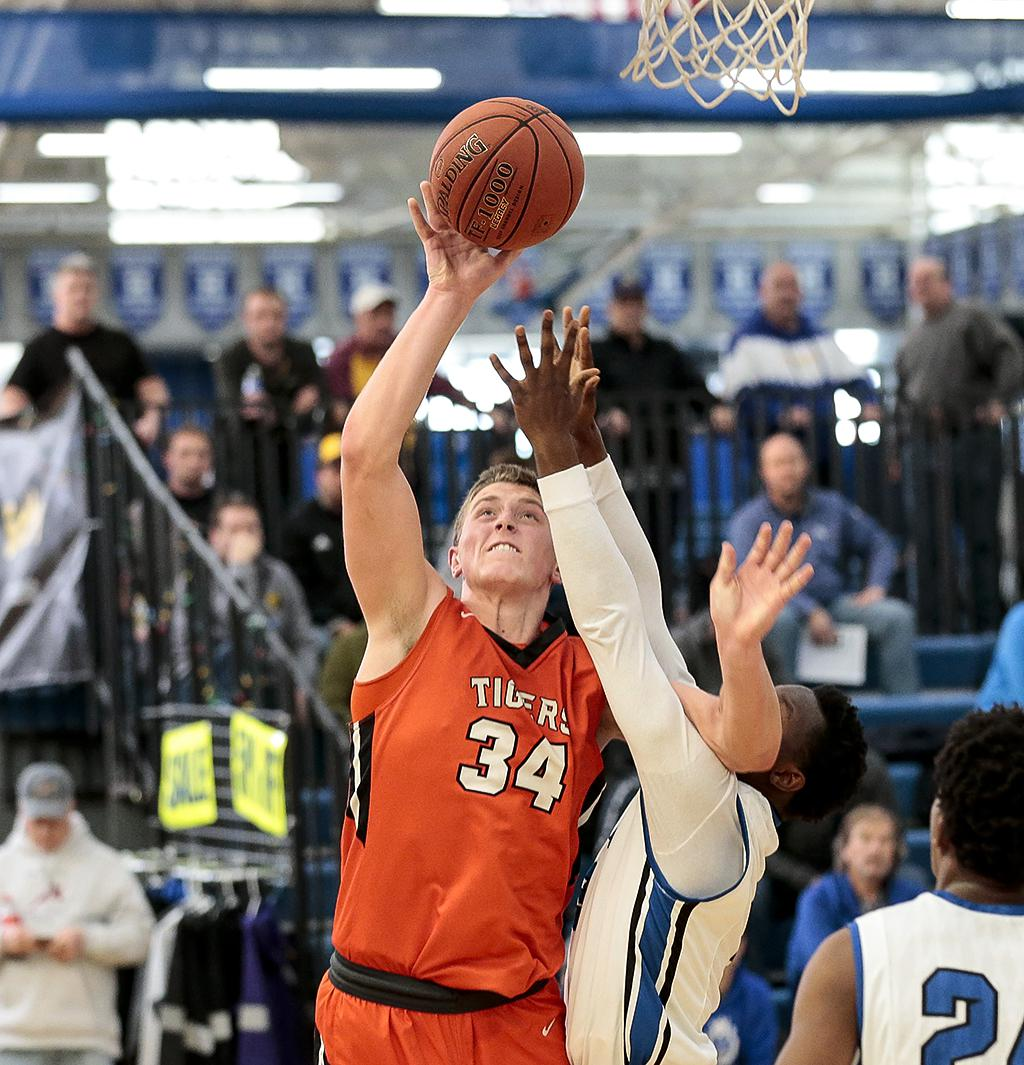 Reid Gastner (34) scores on a lay up late in the second half. Lake City held off an early second half comeback attempt by Minneapolis North to win 65-54 in the Breakdown Tip Off Class at Hopkins High School. Photo by Cheryl A. Myers, SportsEngine