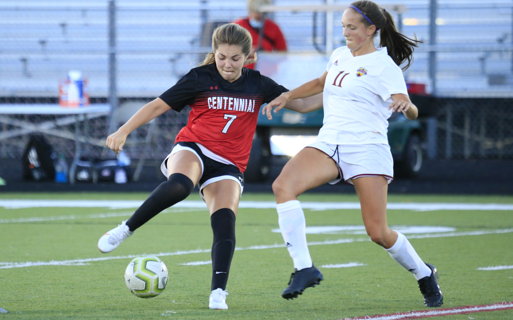 Centennial's Khyah Harper (7) tries to gain control of the ball under pressure from Maple Grove's Avery Toms (11) Wednesday at Centennial High School. Harper had the lone goal in the Cougars' 1-0 defeat of the Crimson. Photo by Jeff Lawler, SportsEngine