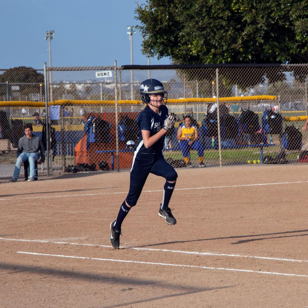 Anna sprinting to 1st base