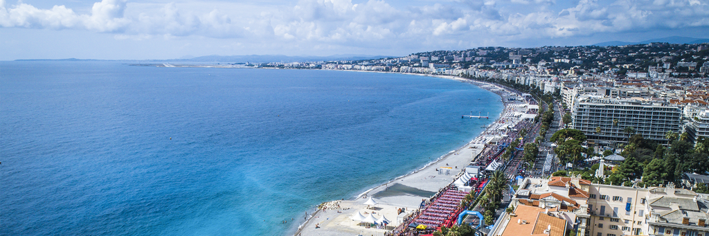 BIrd's eye view of the Promenade des Anglais, the city center and the turquoise waters of the Mediterranean Sea of Nice France