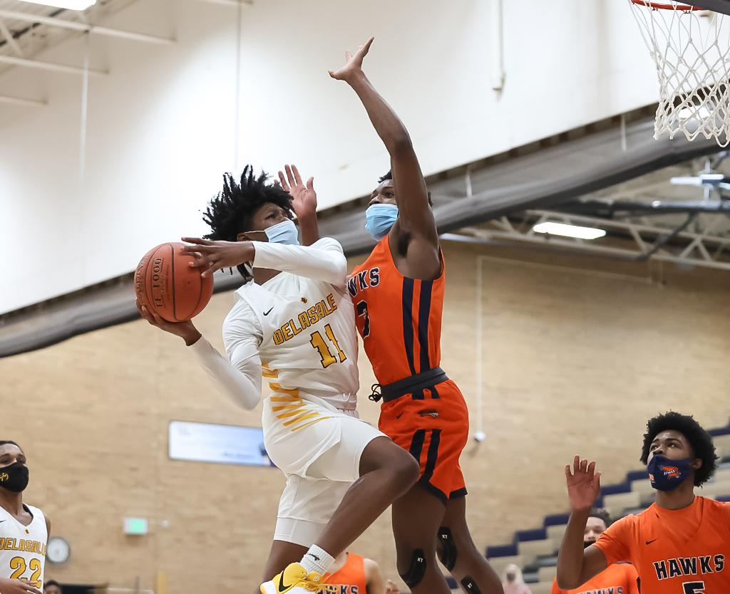 Freshman Casmir Chavis (11) takes the ball in for a layup in the first half. Chavis' 20 points helped DeLaSalle break Robbinsdale Cooper's 12-game winning streak on Tuesday night. Photo by Cheryl A. Myers, SportsEngine