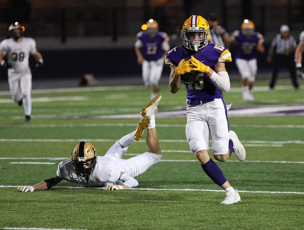 Cretin-Derham Hall's Tyson Schilling (15) breaks away from the last East Ridge defender on a 53-yard touchdown reception, giving the Raiders a 14-point lead in the second quarter. Photo by Cheryl A. Myers, SportsEngine
