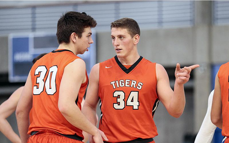 Lake City's Reid Gastner (34) will have his hands full matching up against Stewartville's high-scoring forward Will Tschetter when they play Tuesday. Photo by Cheryl A. Myers, SportsEngine