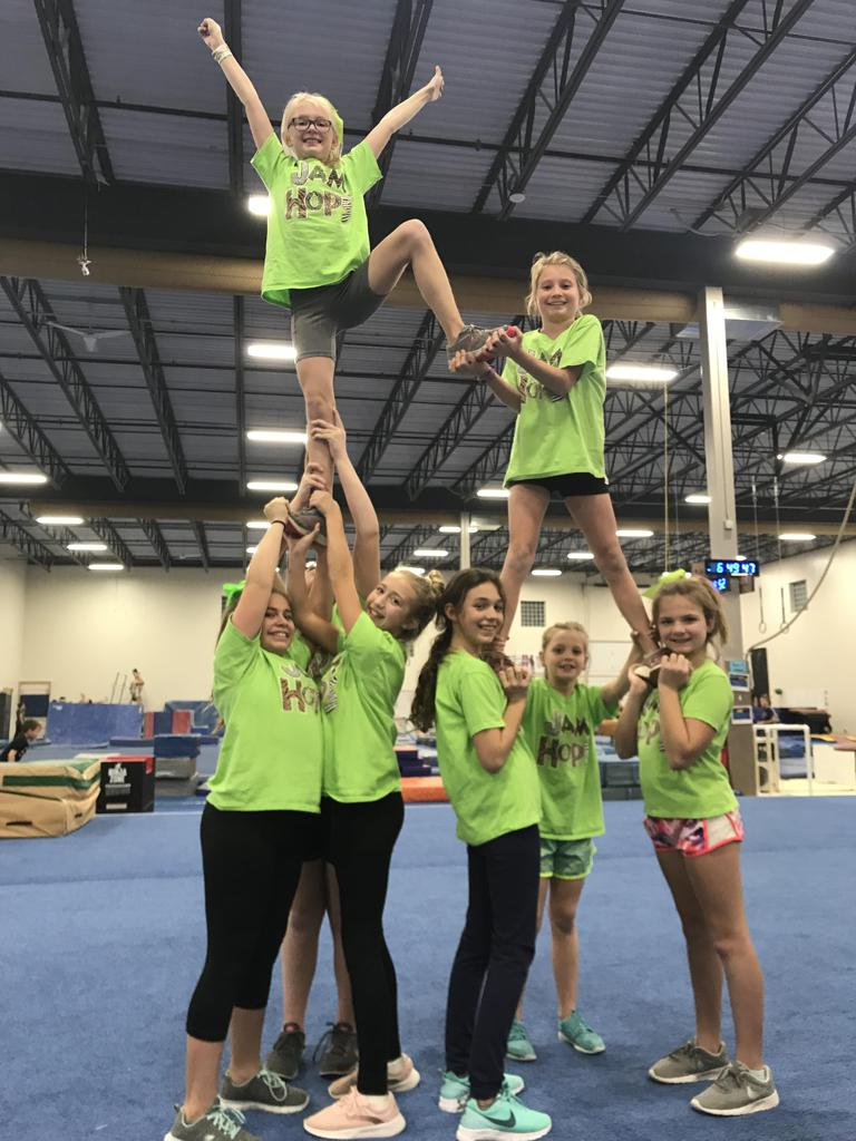 Cheerleaders practicing a cheer formation