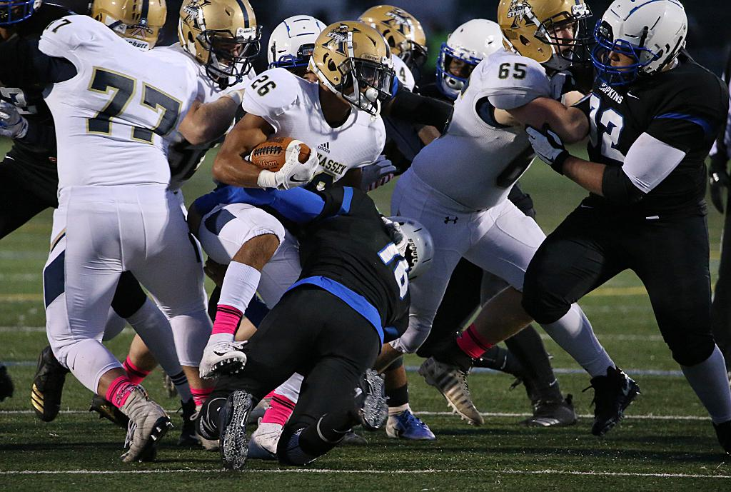 Rolando Alvarez (26) breaks through the line of scrimmage and is brought down by Royals defender James Klecker (16). Chanhassen scored 21 unanswered points and held on to defeat Hopkins 28-20. Photo by Cheryl Myers, Courtesy of Hopkins Football