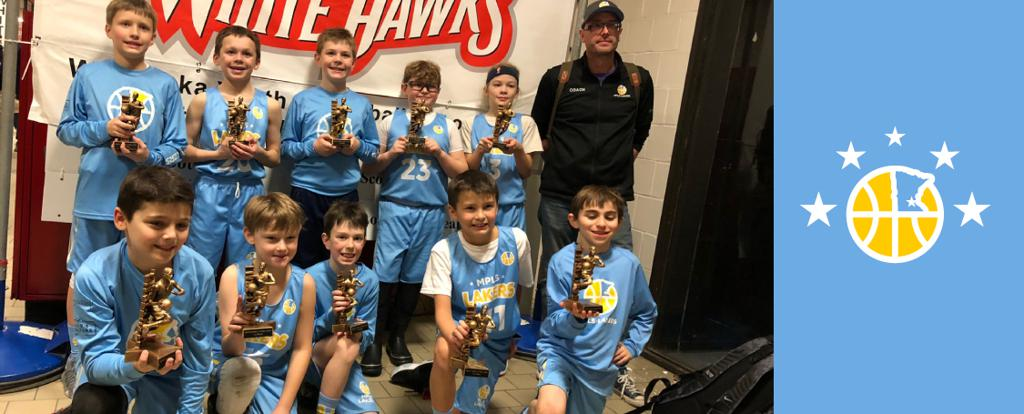 Minneapolis Lakers Youth Basketball Program Boys 4th Grade Blue pose with their Trophies after becoming the Champions at the Westonka White Hawk Classic tournament in Mound, MN