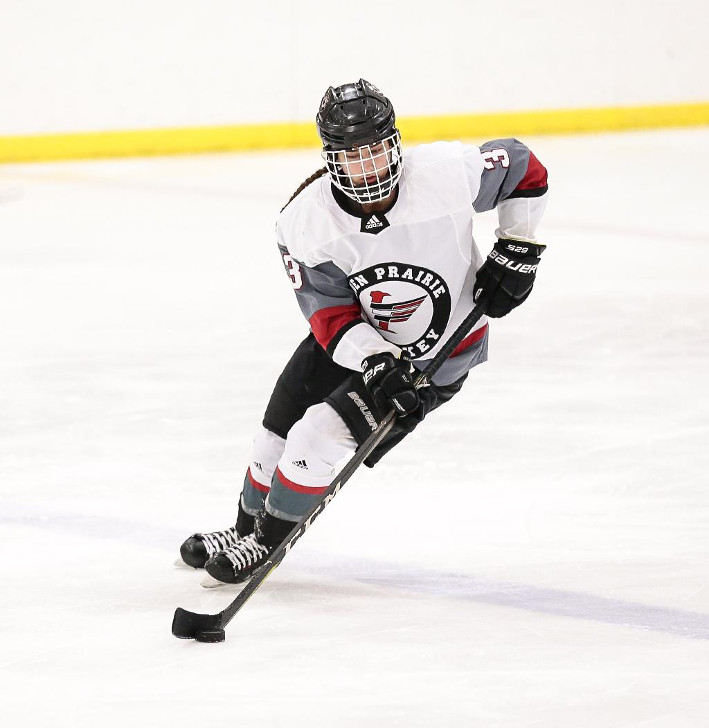The Eagles' Sydney Langseth turns the puck around at the blue line. Langseth scored two goals for Eden Prairie in a 4-3 loss to their Lake Conference rivals from Minnetonka. Photo by Cheryl A. Myers, SportsEngine