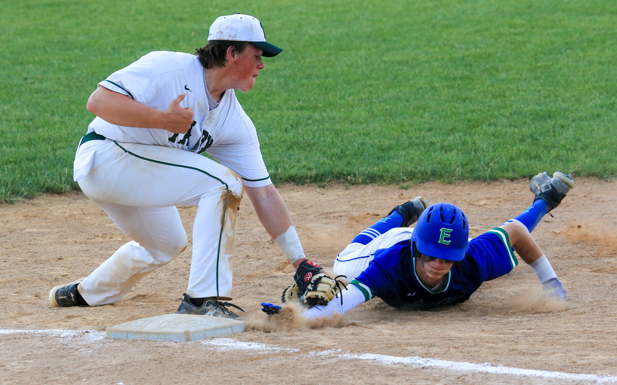 Park of Cottage Grove's Will Smoot applies the tag to catch Eagan's Liam Martin on a pickoff play early in Game 1 of the Class 4A, Section 3 final. The Wolfpack defeated the Wildcats 5-0 to force a second game. Photo by Jeff Lawler, SportsEngine