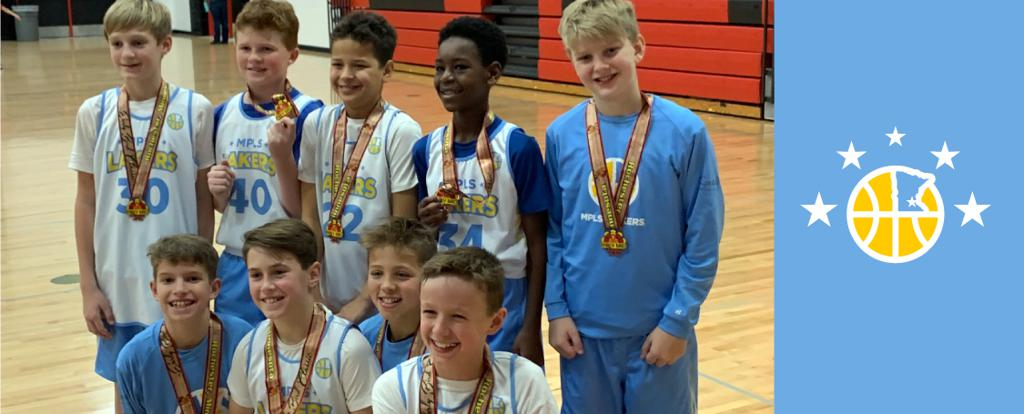 Minneapolis LakersBoys 6th Grade Gold pose with their medals after earning 3rd place at the Rochester Early Bird Classic tournament in Rochester, MN